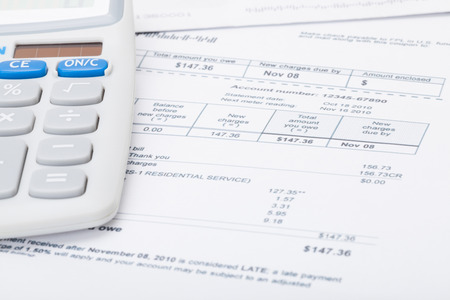 electricity prices: Utility bill and calculator Stock Photo