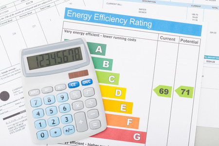 Calculator with utility bill and energy efficiency chart photo