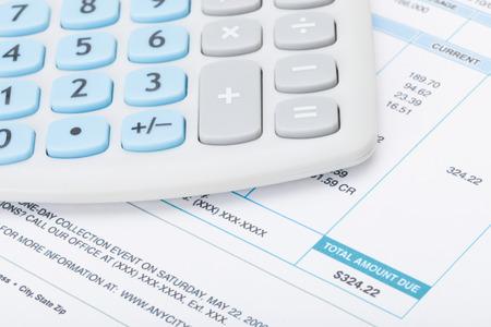 Calculator over utility bill - studio shot