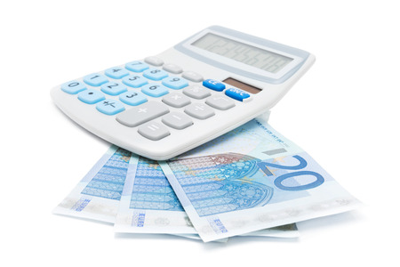 Calculator and 20 EURO banknotes on a white background
