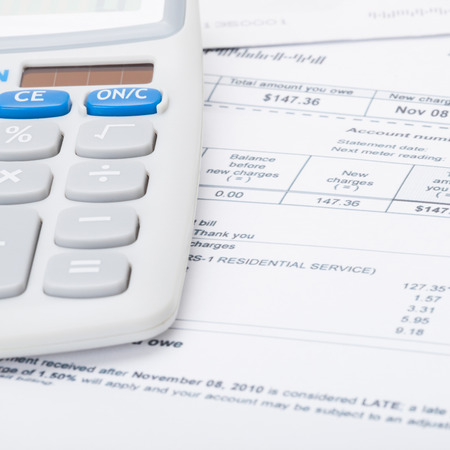 utility payments: Utility bill and calculator  Stock Photo