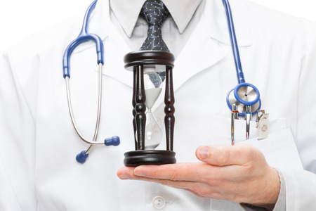Medical doctor with hourglas in his hand
