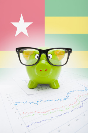 Piggy bank with flag on background - Togo photo