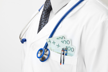 corruptible: Doctor with money in his pocket - closeup shot