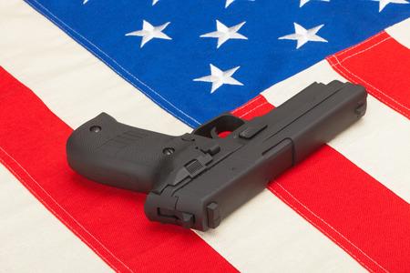 amendment: Handgun laying over USA flag - studio shoot