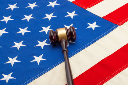 Wooden judge gavel over USA flag - closeup shoot photo