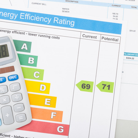 utility payments: Calculator with utility bill and energy efficiency chart - 1 to 1 ratio Stock Photo