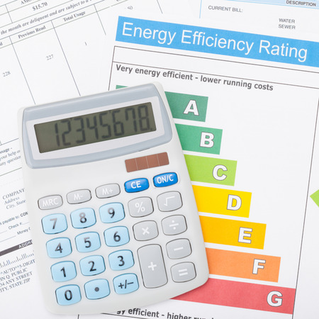 Calculator with utility bill and energy efficiency chart - 1 to 1 ratio photo
