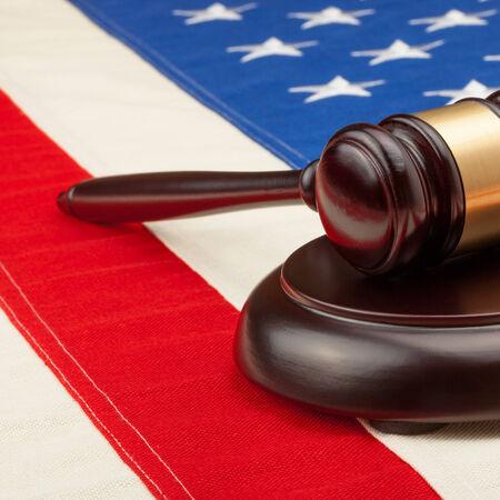 Wooden judge gavel and soundboard laying over USA flag - studio shoot - 1 to 1 ratio photo