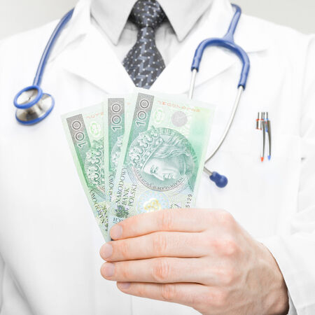 doctor holding money: Medical doctor holding money in his hand  Stock Photo