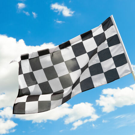 Checkered flag waving in the wind  photo