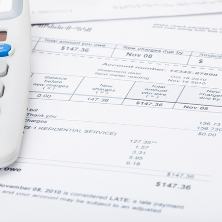 utility payments: Utility bill papers with calculator