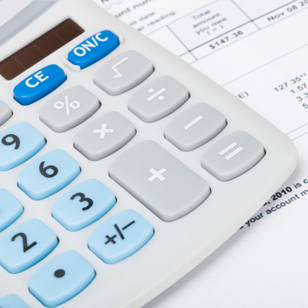 utility payments: Calculator with utility bill under it