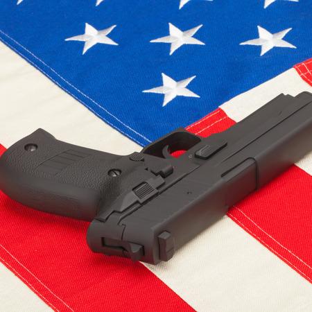 paranoia: Handgun over US flag  Stock Photo