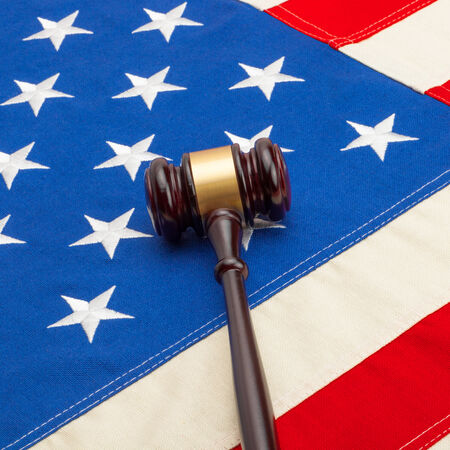 international criminal court: Judge gavel with US flag - 1 to 1 ratio