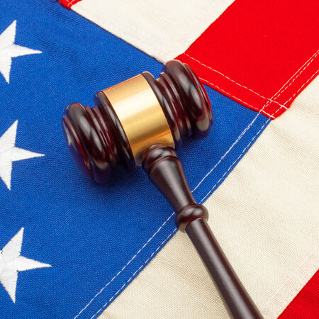 Wooden judge gavel with US flag photo