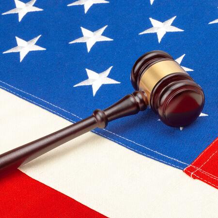 Studio shot of judge gavel over US flag  photo