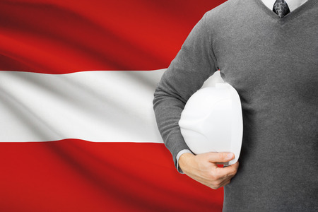architector: Architect with flag on background  - Austria Stock Photo
