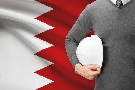 architector: Architect with flag on background  - Bahrain Stock Photo