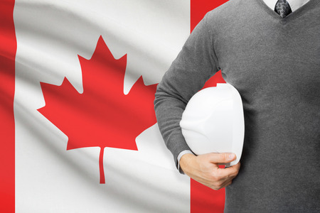 Architect with flag on background  - Canada
