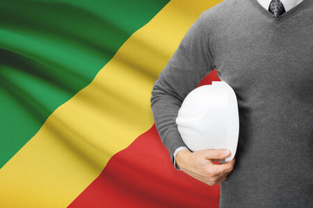 architector: Architect with flag on background  - Republic of the Congo