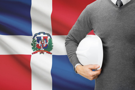 architector: Architect with flag on background  - Dominican Republic
