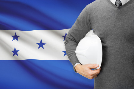 architector: Architect with flag on background  - Honduras Stock Photo