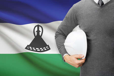 architector: Architect with flag on background  - Lesotho
