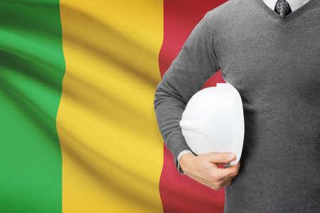 Architect with flag on background  - Mali photo