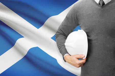 architector: Architect with flag on background  - Scotland Stock Photo