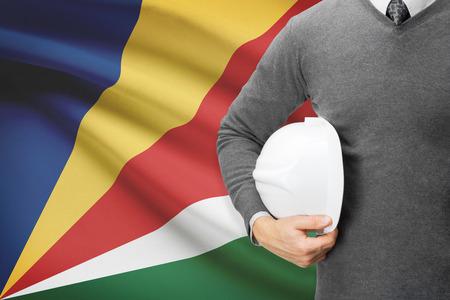 architector: Architect with flag on background  - Seychelles Stock Photo
