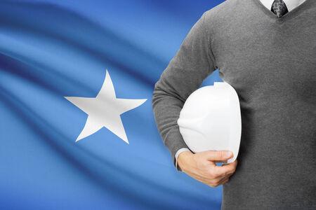 architector: Architect with flag on background  - Somalia Stock Photo