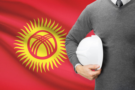 architector: Architect with flag on background  - Kyrgyzstan