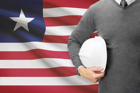 architector: Architect with flag on background  - Liberia Stock Photo