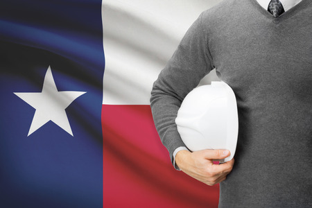Architect with US state flag on background  - Texas