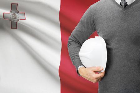 architector: Architect with flag on background  - Malta
