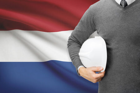 architector: Architect with flag on background  - Netherlands Stock Photo