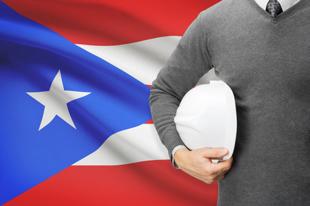 architector: Architect with flag on background  - Puerto Rico Stock Photo