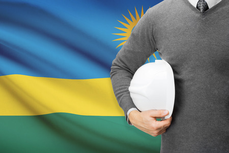 architector: Architect with flag on background  - Rwanda