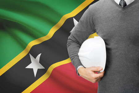 architector: Architect with flag on background  - Saint Kitts and Nevis Stock Photo
