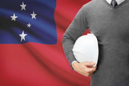 architector: Architect with flag on background  - Samoa Stock Photo