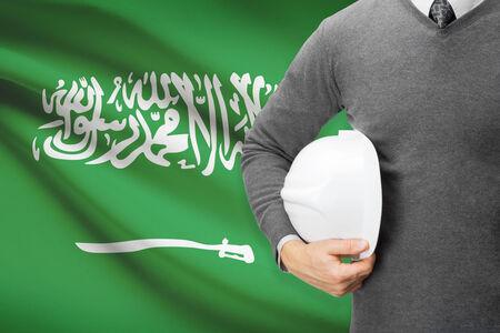 architector: Architect with flag on background  - Saudi Arabia