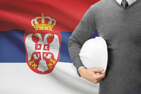 architector: Architect with flag on background  - Serbia