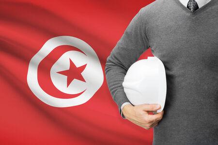 architector: Architect with flag on background  - Tunisia