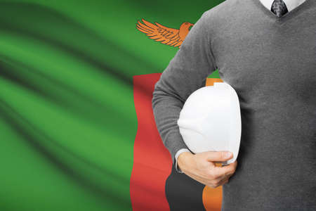 architector: Architect with flag on background  - Zambia