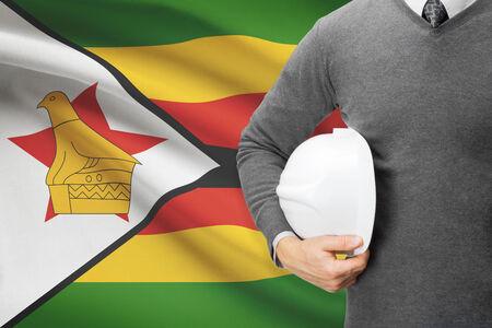 architector: Architect with flag on background  - Zimbabwe Stock Photo