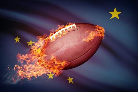 college footbal: Pelota de f�tbol americano con la bandera en serie apaisada - Alaska