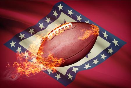 college footbal: Pelota de f�tbol americano con la bandera en serie apaisada - Arkansas Foto de archivo