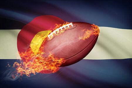 college footbal: Pelota de f�tbol americano con la bandera en serie apaisada - Colorado Foto de archivo