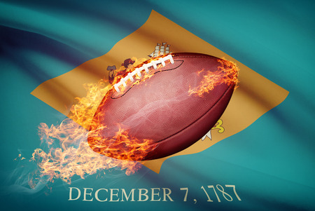 college footbal: American football ball with flag on backround series - Delaware Stock Photo